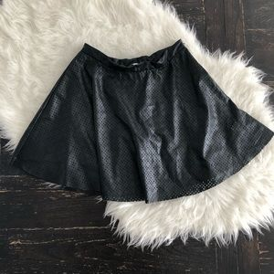 Faux leather perforated fur and flare skirt. Skirt